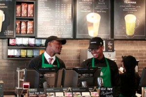 Baristas David Merrick (l.) and Nigel Armstrong (r.) predict the new Jamaica store will have a good effect on the community. Photo Credit: Michael Shain