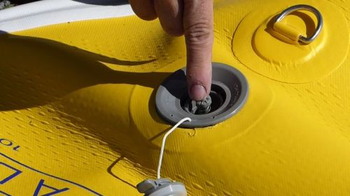 Opening the military valve to the inflate position.