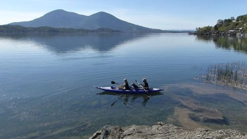 AquaGlide Chelan Tandem paddled by two with dog.