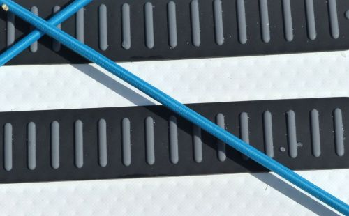 Rubber deck grip under the rear deck lacing