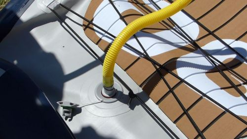 Attaching the pump hose to the board.