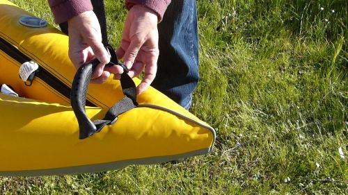 Molded, adjustable carrying handle