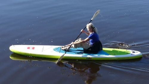"""Red Paddle Voyager 12'6"""" on the water."""
