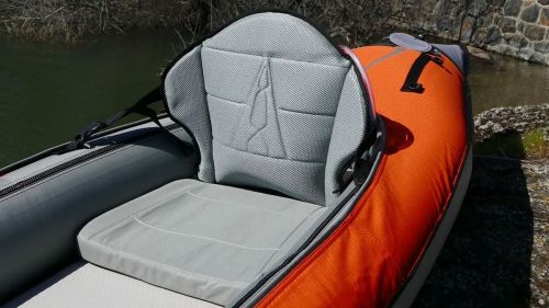 High-backed lumbar seat with paddle base.