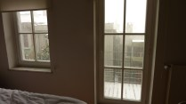 Bedroom looking out to balcony
