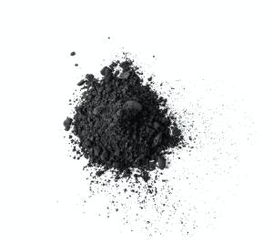 Activated charcoal powder isolated on white background.