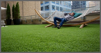 Man lounging on office rooftop patio