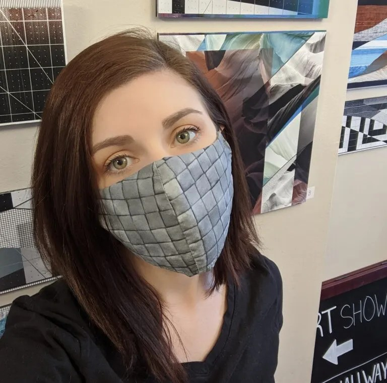 Andrea LaRose, co-founder of second street studios, is wearing a mask and looking into the camera.