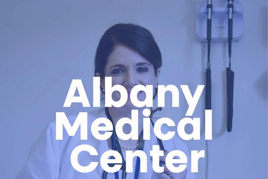 """A female doctor smiles for the camera with a super that reads """"Albany Medical Center"""" goes across"""