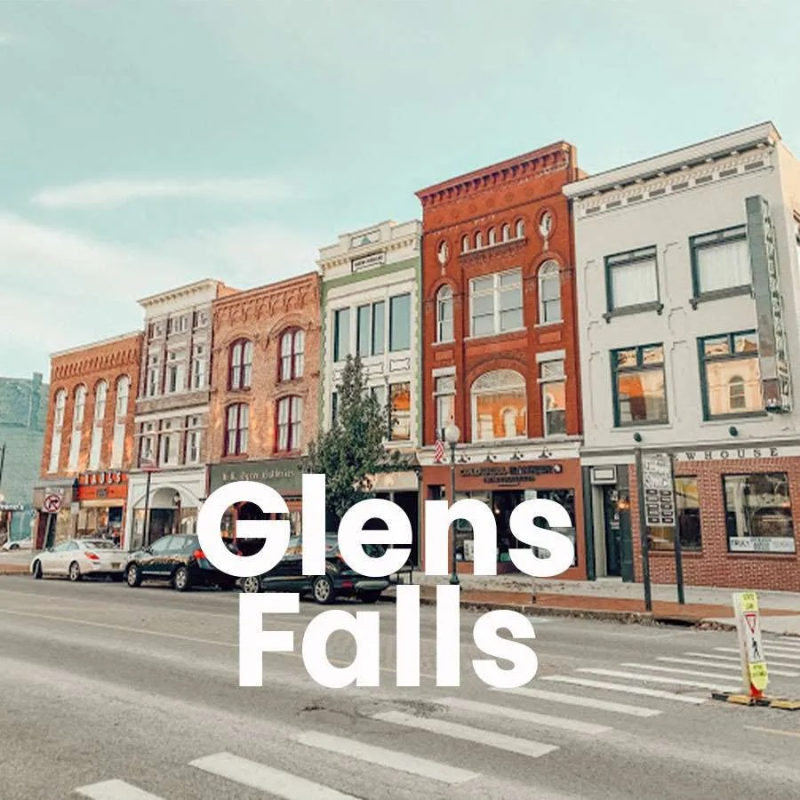 """A photo of a street in downtown Glens Falls with a super over it that says """"Glens Falls"""""""