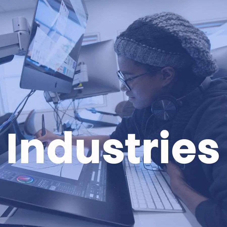 """A woman designs on a computer screen with a super that says """"Industries"""" across."""