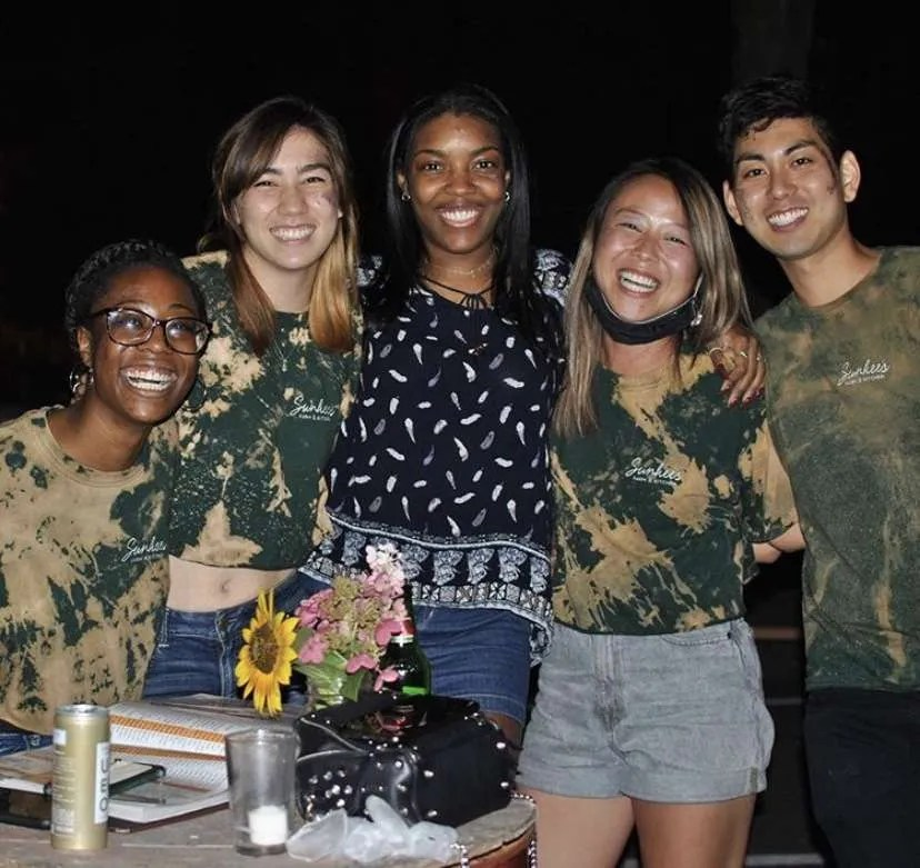 A group of young adults smile at the camera