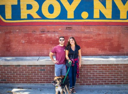 Couple in Troy, NY with dog