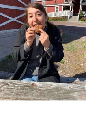 Gabby eating apple cider doughnut