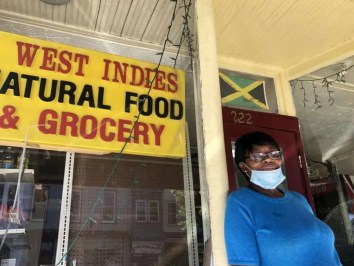 Paulette Clarke in front of West Indies Natural Food and Grocery