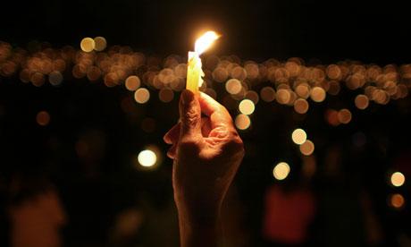 A small light can spark a revolution. Photograph: William Fernando Martinez/AP