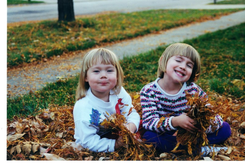 Juliana and Katie Playing in the Leaves
