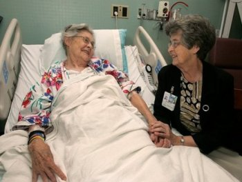 chaplain with hospital patient