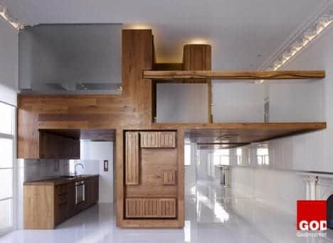 Hogarth Architects transformed another large one-room flat in London into a stylish apartment using a wood insert that creates a separated kitchen and loft. It's essentially one big piece of furniture custom-made for the space.