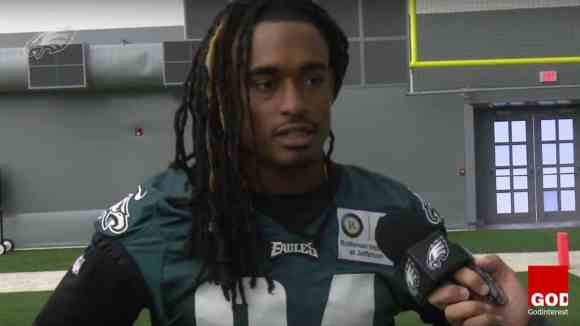 Philadelphia Eagles wide receiver Marcus Johnson tweeted a photo of him being baptized in the team's hotel swimming pool, just hours before the Eagles' victory Thursday night over the Carolina Panthers. (Image source: YouTube screenshot)