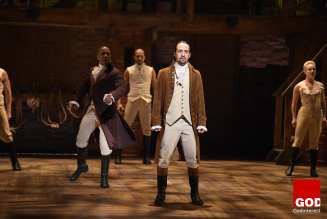 """NEW YORK, NY - FEBRUARY 15: Actor Leslie Odom, Jr. (L) and actor, composer Lin-Manuel Miranda (R) perform on stage during """"Hamilton"""" GRAMMY performance for The 58th GRAMMY Awards at Richard Rodgers Theater on February 15, 2016 in New York City. (Photo by Theo Wargo/WireImage)"""