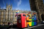 Gay campaigners celebrate outside the Houses of Parliament in London. AFP: Andrew Cowie