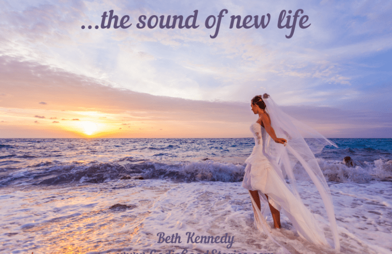 woman in white bridal gown walking into ocean purple skies at sun set/sun rise with text The Sound of new Life, Beth Kennedy, www.GodisGoodStories.com