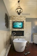 Astonishing and cozy bathrooms design ideas with fireplace 06
