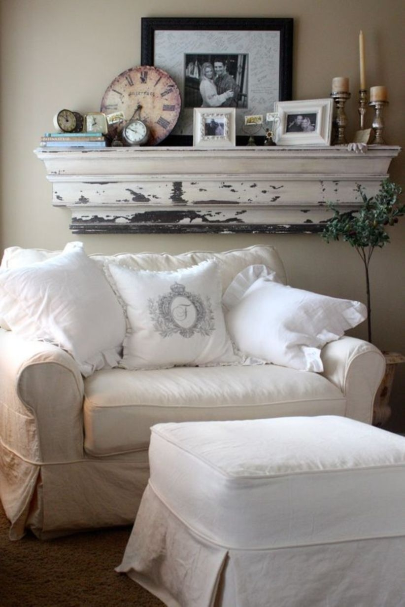 Wall mantel with pictures and candles displayed