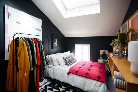 Vintage attic bedroom with wall of skylights05