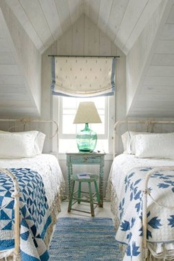Vintage attic bedroom with wall of skylights17
