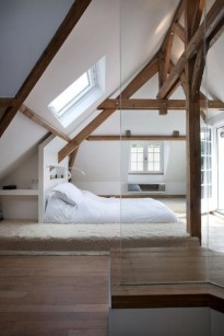 Vintage attic bedroom with wall of skylights24
