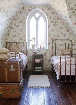 Vintage attic bedroom with wall of skylights25