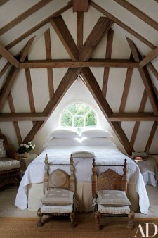 Vintage attic bedroom with wall of skylights33
