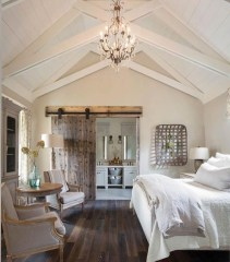 Vintage attic bedroom with wall of skylights43