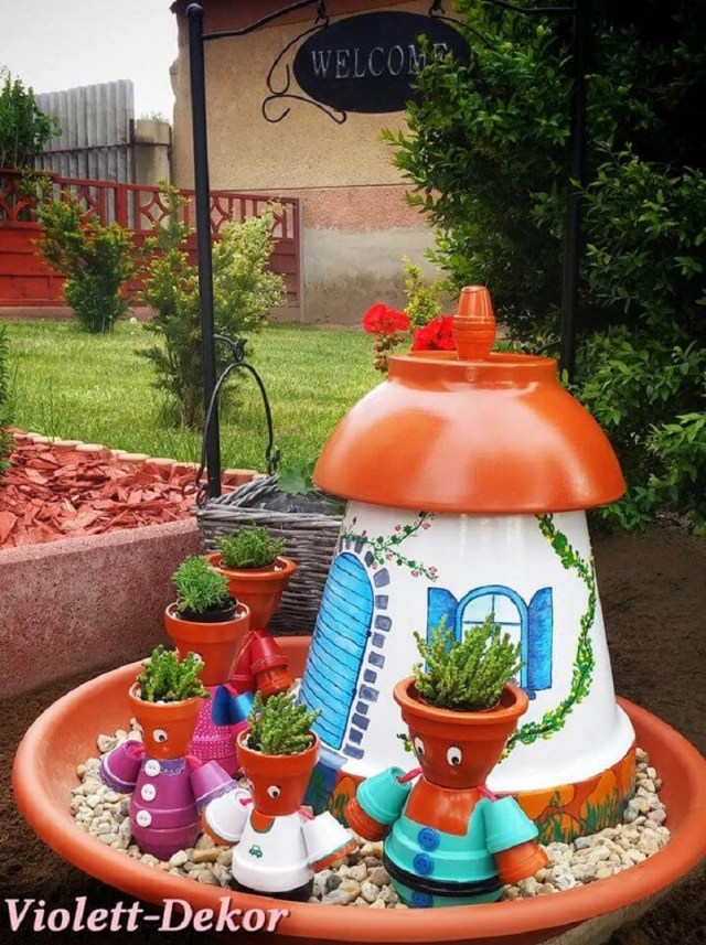 Clay pot family with a cute house