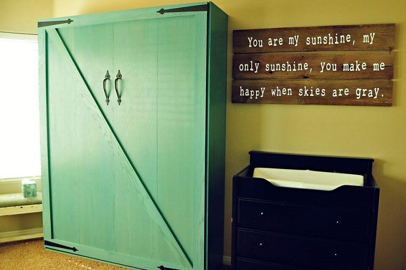 Green storage cabinets with a bed inside