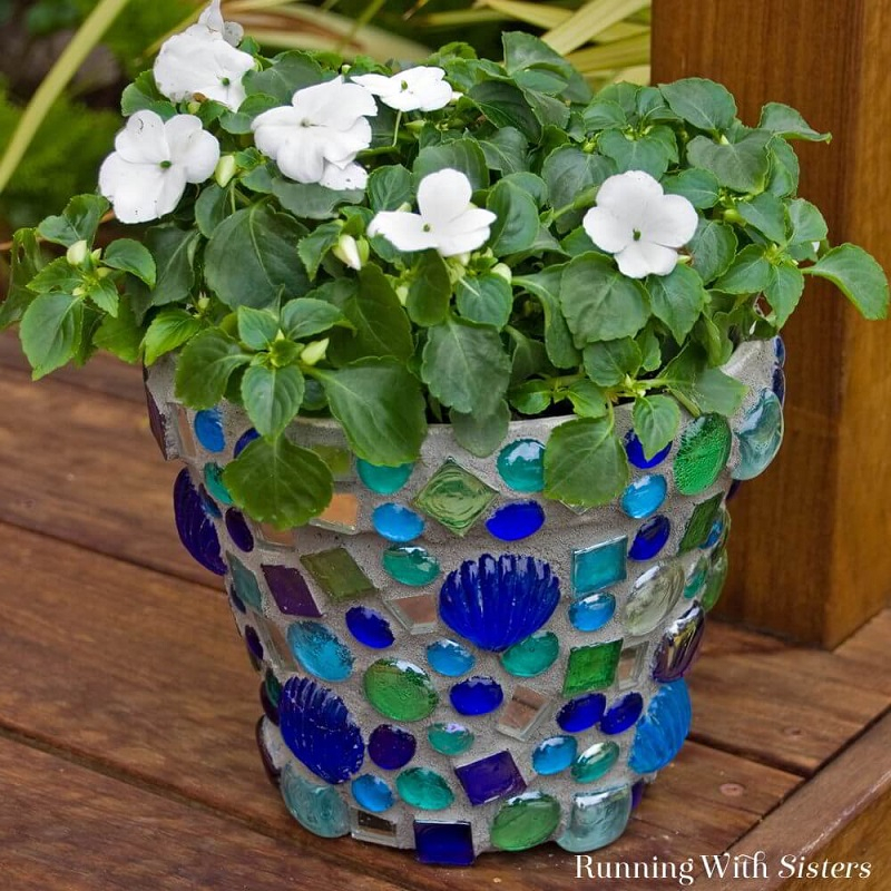Mosaic stones on a clay flower pot