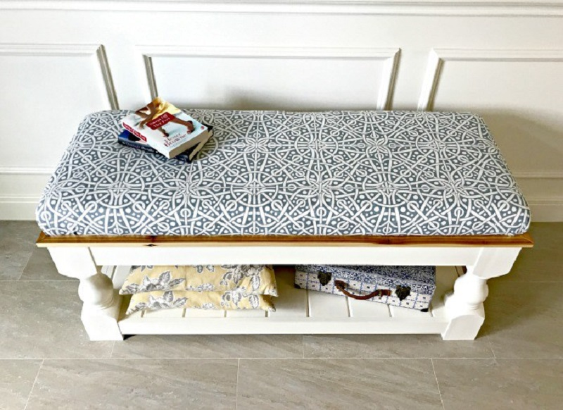 an open storage space and cool printed upholstery bench