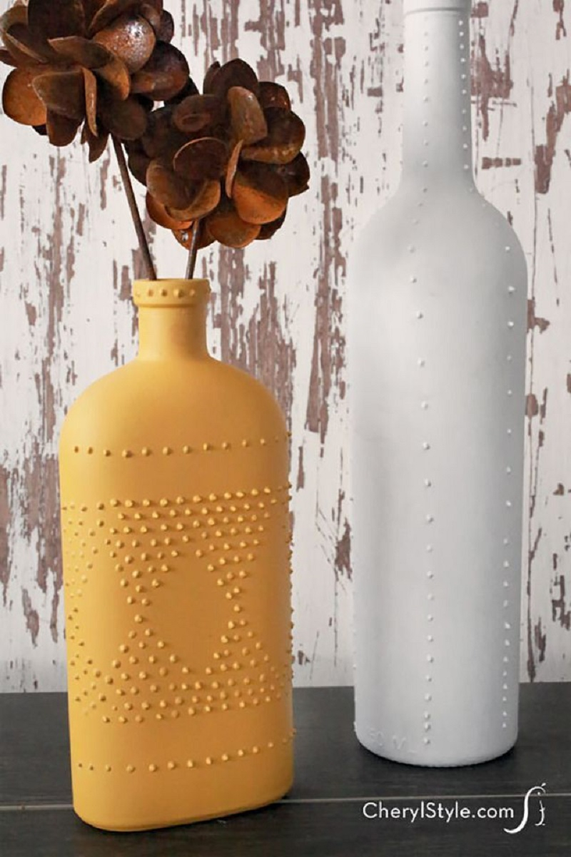 Textured surface with puff paint wine bottle Unexpectedly Aesthetic DIY Wine Bottle Crafts That Magically Shining