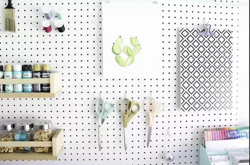 Craft display on pegboard