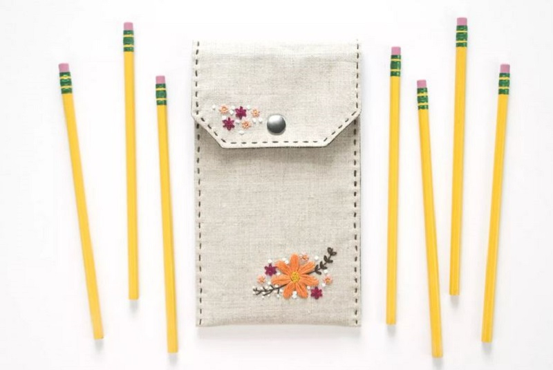 Embroidered flower on a pencil case