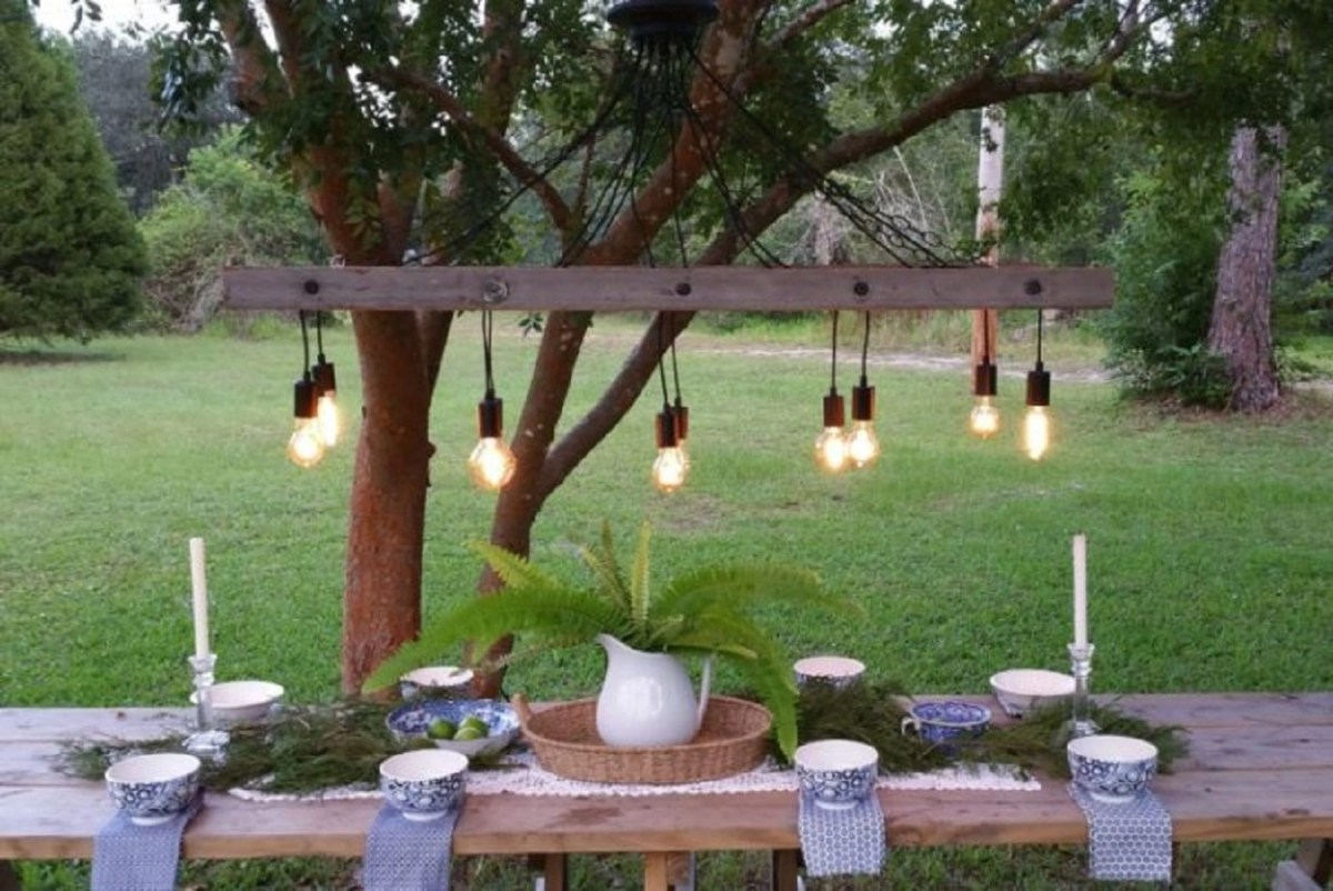 Vintage ladder with lights DIY Magical Hanging Decoration Ideas To Bring Your Outdoor Alive