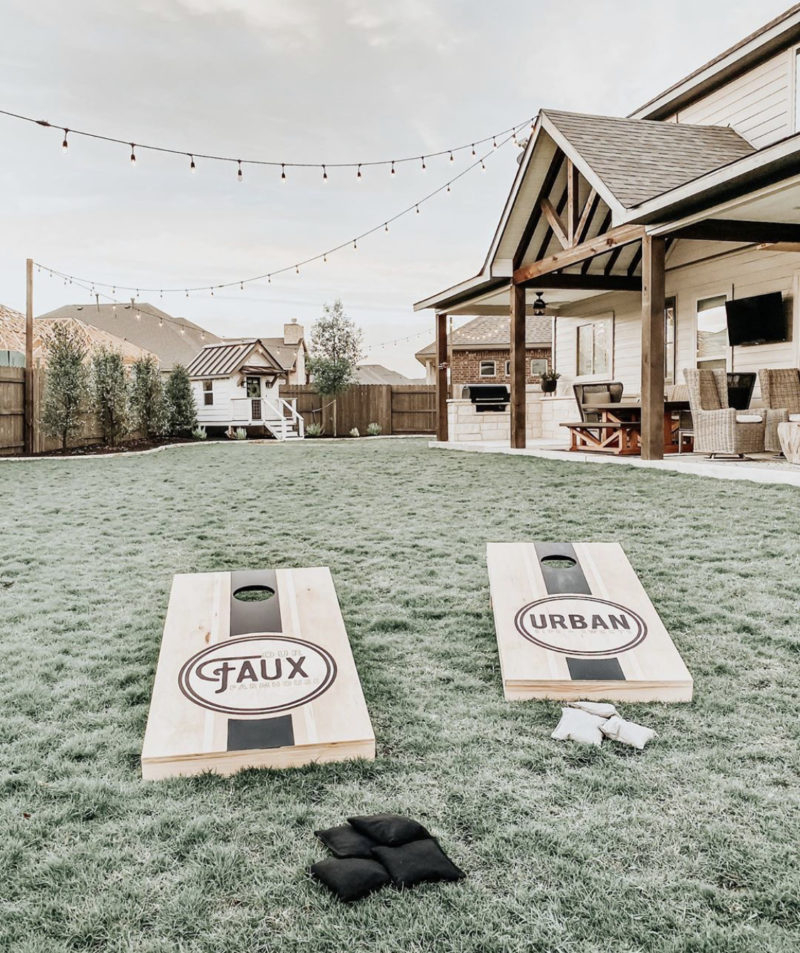 Farmhouse backyard cornhole DIY Cornhole Board Plans You Can Create Now For Your Backyard