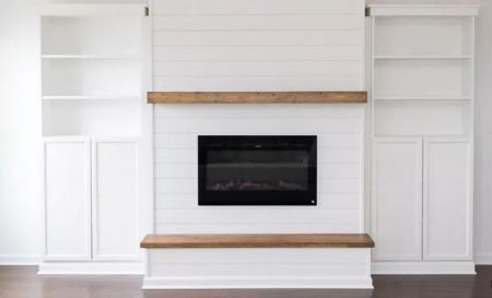 Built-in bookcase with electric fireplace