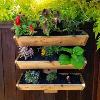 Planter boxes mounted to the deck