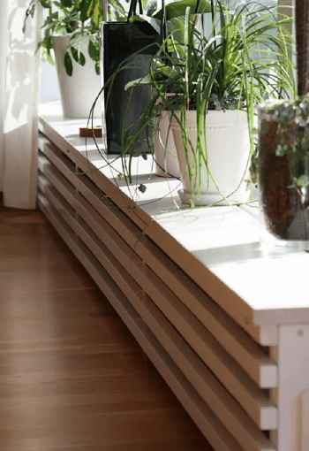 Plant shelf DIY Stylish Radiator Covers To Keep Your Home Pretty