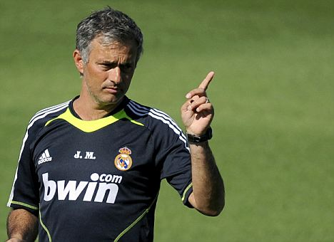 Real Madrid's new coach Portuguese Jose Mourinho attends the team's first training session of the season at Real Madrid's sport city in Madrid on July 16, 2010. AFP PHOTO / DANI POZO (Photo credit should read DANI POZO/AFP/Getty Images)(Photo Credit should Read /AFP/Getty Images)