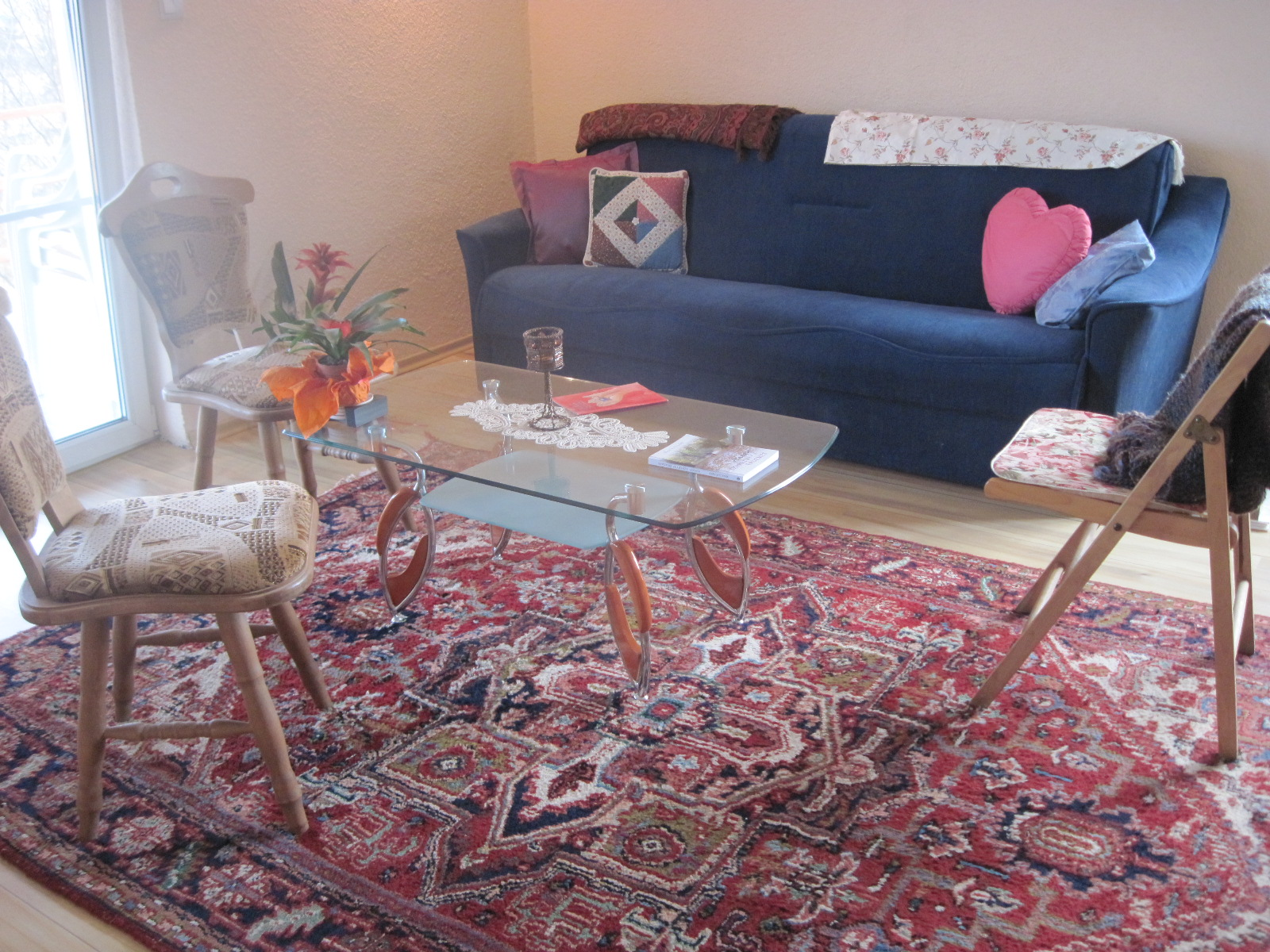 """A divan, coffee table, and 3 chairs on my carpet """"find""""...a place for you"""