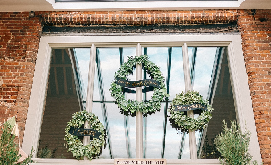 Sarah Jane Ethan - three wreaths on the entrance windows